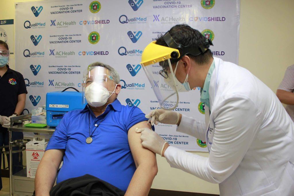 Ramon-Abadilla-COO-Qualimed-San-Jose-del-Monte-Bulacan-receives-first-AstraZeneca-dose-in-program-launch